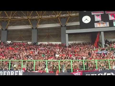 FOOTBALL INDONESIA: Persija Jakarta fans celebrate a penalty going in