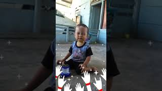 Funny baby on the floor