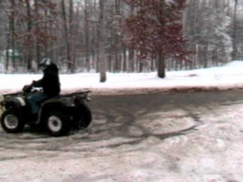 Four-wheelers doing donuts in the snow