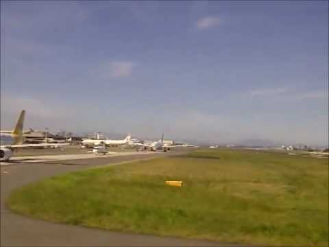 commercial airplanes waiting for takeoff on runway with heavy traffic