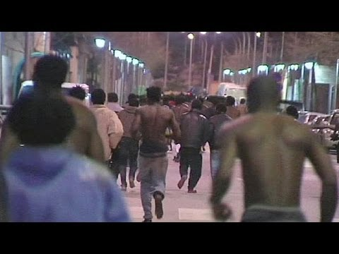 African migrants storm border into Spain's Melilla