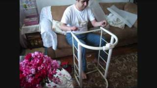 Daddy is assembling the  bassinet/cradle