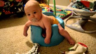Desmond in his Bumbo, 4 months