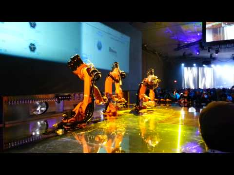 A trio of bartender robots serving drinks and using a visual queue system at Google I/O 2013