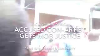 Brutal mob justice on accused con-artist by angry crowd who accuse him of cashpoint scamming