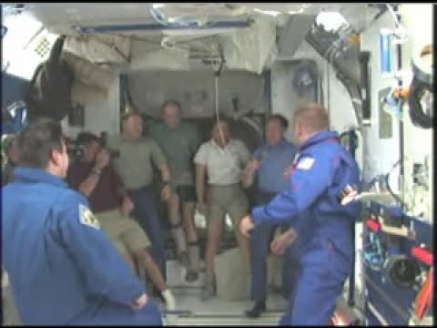 Come on in! Station Crew Greets STS-126 Astronauts