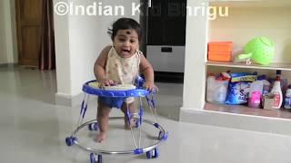 7 months kid enjoying in baby Walker Indian kids in Walker Baby learning how to walk Indian Bhrigu