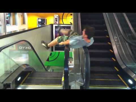Escalator Spin Fail....hilarious, u will laugh in the first 5 sec! Music Videos