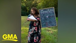 Woman poses with dissertation in newborn photoshoot spoof | GMA Digital