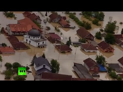 Aerial flood footage: 'Worst in century' deluge swamps Balkans