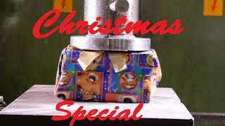 Crushing Christmas with hydraulic press