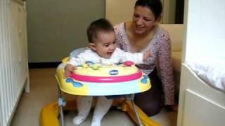 7 months: 'Running away' in her baby walker