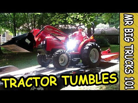 NEW BIG WHEEL RED TRACTOR OFF THE TRAILER: MrBigTrucks101