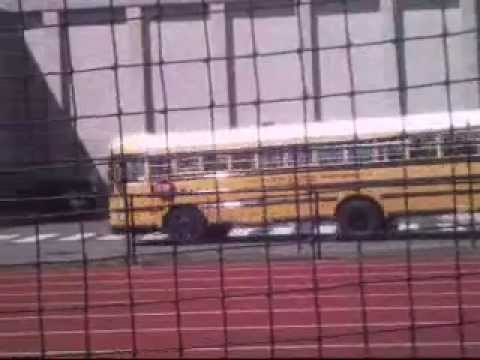 buses entering Fairfield Ludlowe High School and leaving Roger Ludlowe Middle School