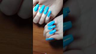 Nice blue new polish, natural long nails wearing cool polish