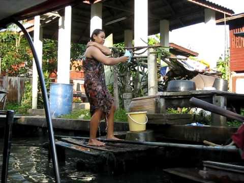 Martyna in Bangkok, Thailand, The Damnoen Saduak Floating Market . Woman washing herself