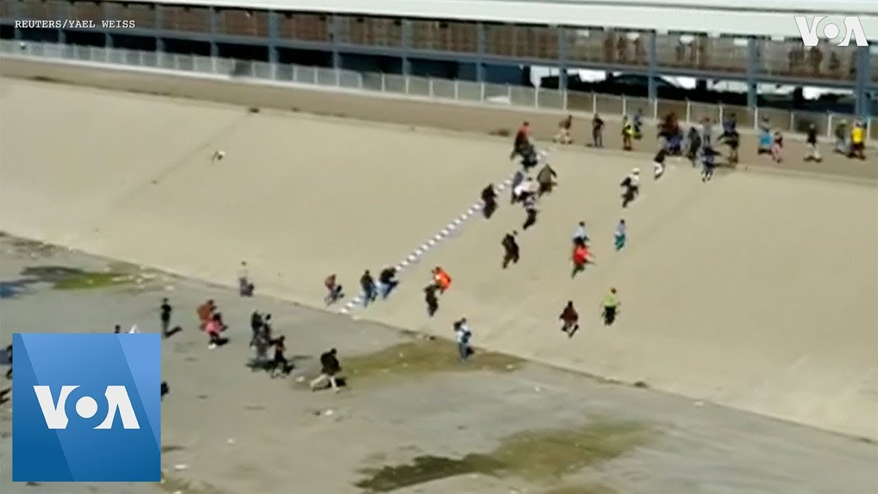 Migrants Run Toward U.S. Border Prior to Tear Gas