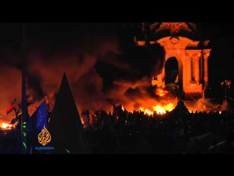 Ukraine protest camp ablaze as police move in