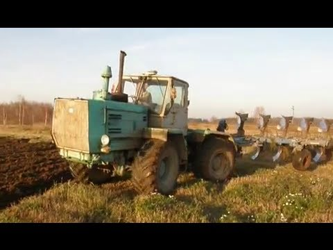 XTZ T-150K ploughing with reversible five furrow plow