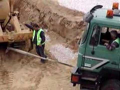 truck  stuck in mud , greece  / constructing golf course Music Videos