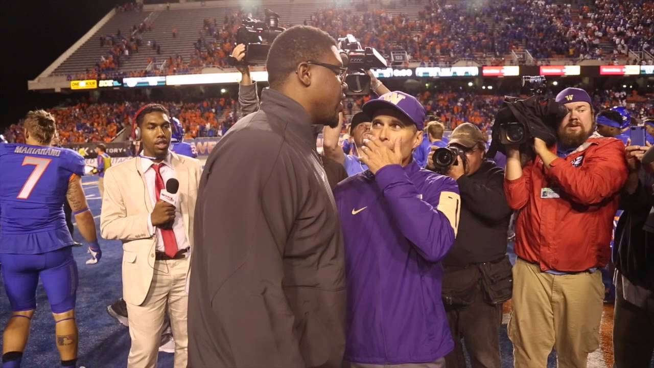 Chris Petersen greets Boise State coaches and players after the game