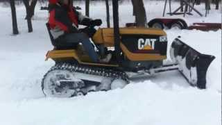 Mini Cat Challenger Tractor snow plowing