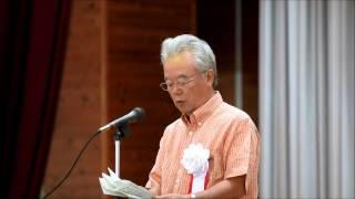 第68回沖縄県植樹祭で知事の挨拶を代読する冨川盛武副知事