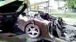 Russians tow a car (burned ferrari 612)