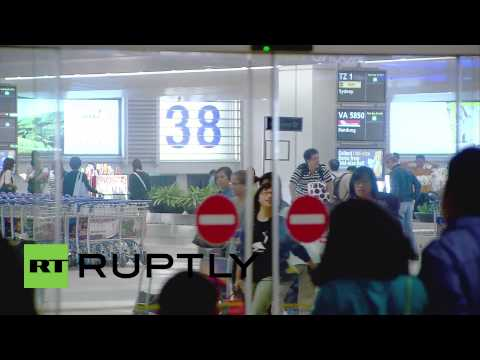 Singapore: Relatives wait for news of the missing AirAsia flight QZ8501