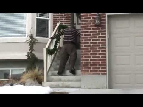 Paraplegic Walking Up Stairs Into Friends House with Leg Braces