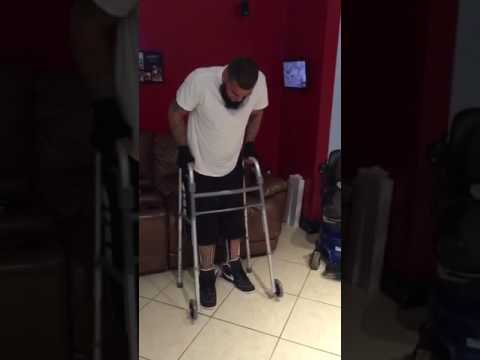 Paraplegic - JR standing with leg braces for the first time