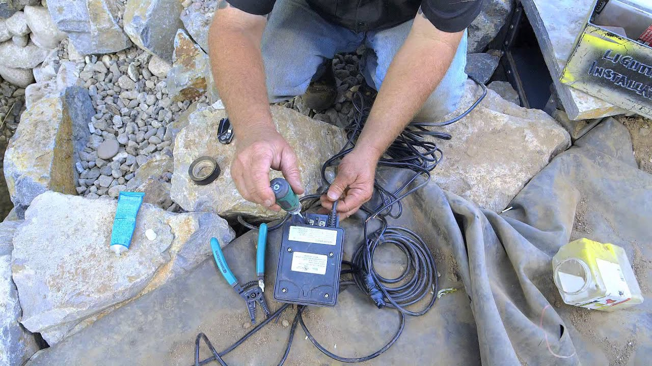 How to build a fish pond part 19 wiring pond lights for Pond pump installation