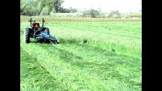 JOHN DEERE 4300 WITH FORD 505 SICKLE MOWER