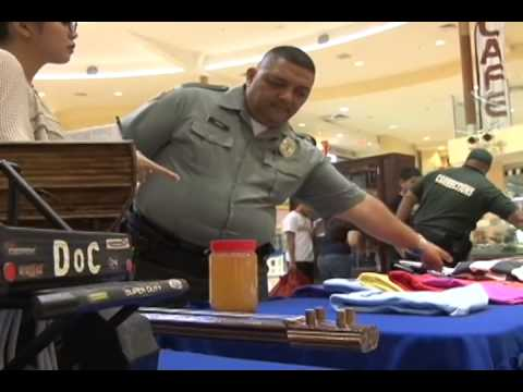 Corrections officers visit mall to teach public about prison