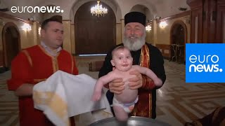 This baptism in Georgia is enough to make your head spin