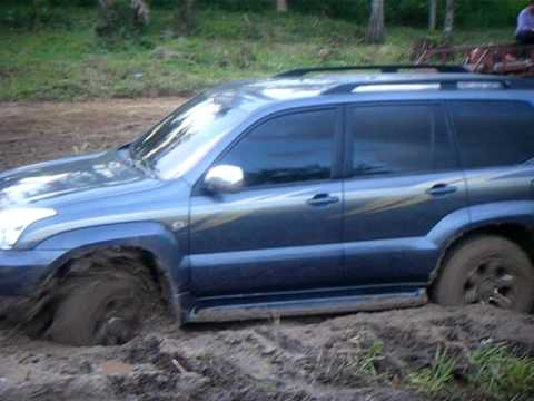 Toyota Land Cruiser Prado off road on mud
