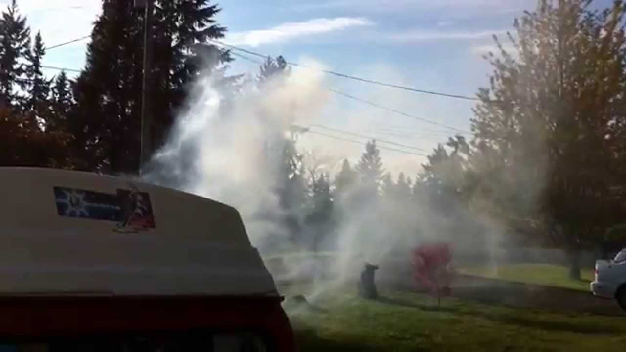 White Lawn Mower Lawn Mower Spewing Smoke