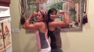 50  year old farm girl and her 68 year old aunt enjoy a moment of fitness modeling poses and fun