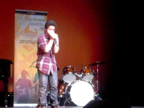 A 12-year-old from Gulliver Academy performs on the harmonica
