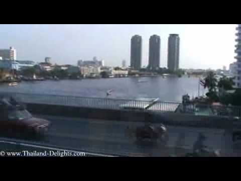 Sky Train Ride from Krung Thon Buri to Saphan Taksin, Bangkok.