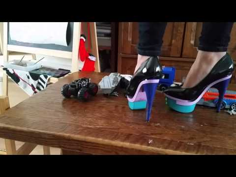 Sexy high heels play with toys on the table