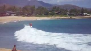 Surfing at Makaha Beach, Oahu, Hawaii