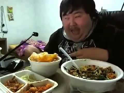 Fat Asian Guy Eating Food