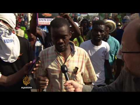 Haitians protest against president and UN