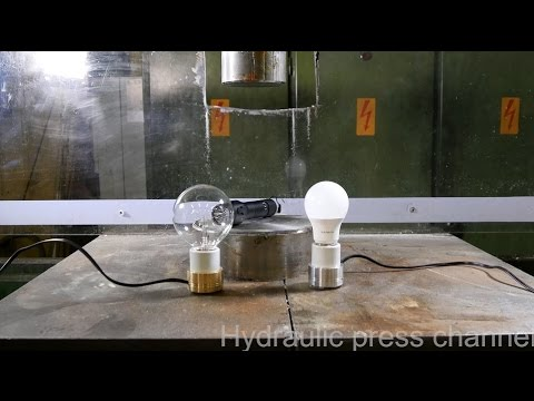 Crushing lamps while they are turned on with hydraulic press
