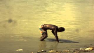 A man searching for money in River Ganga