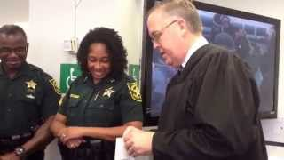 Judge Hurley and the Broward Sheriffs Office make Justin Aucoin an honorary bailiff.