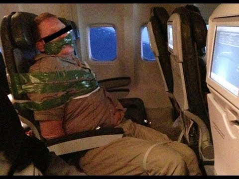 Drunk, Moaning Airline Passenger Taped Down - VIDEO