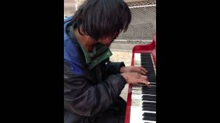 Man on the street plays beautifully