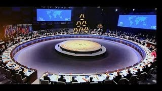 Illuminati pyramid hologram at Nuclear Summit 2014 & world leaders wearing pyramid lapel pins